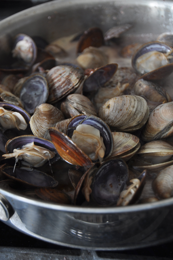 After adding the clams, give them about 6 minutes to open up.