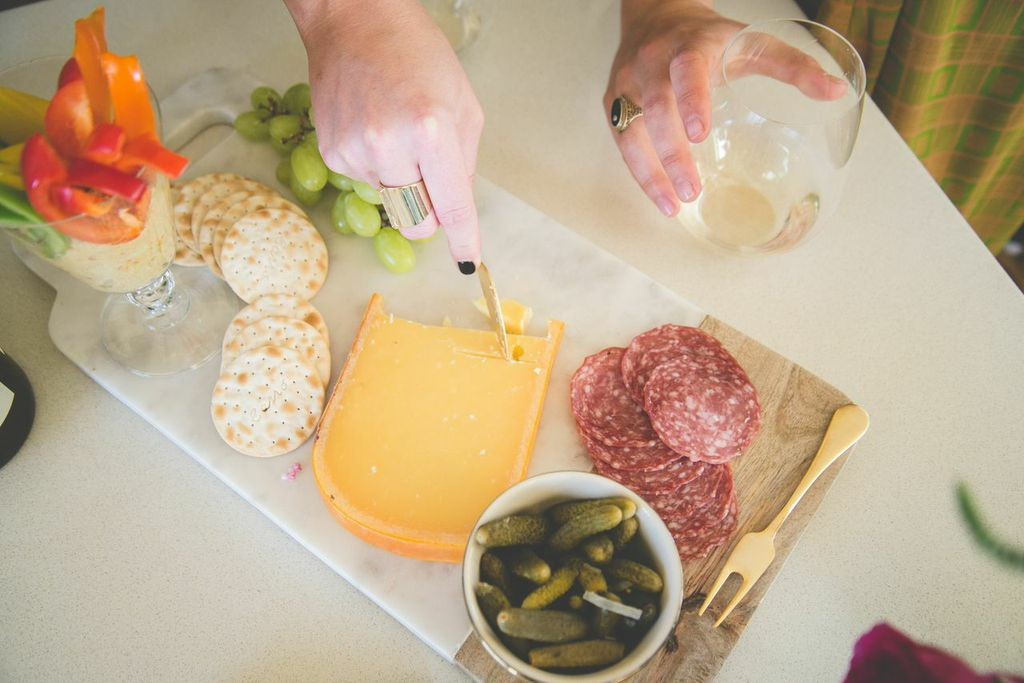 Happy Hour: Pair the wine you choose to drink with cheese and assortments.
